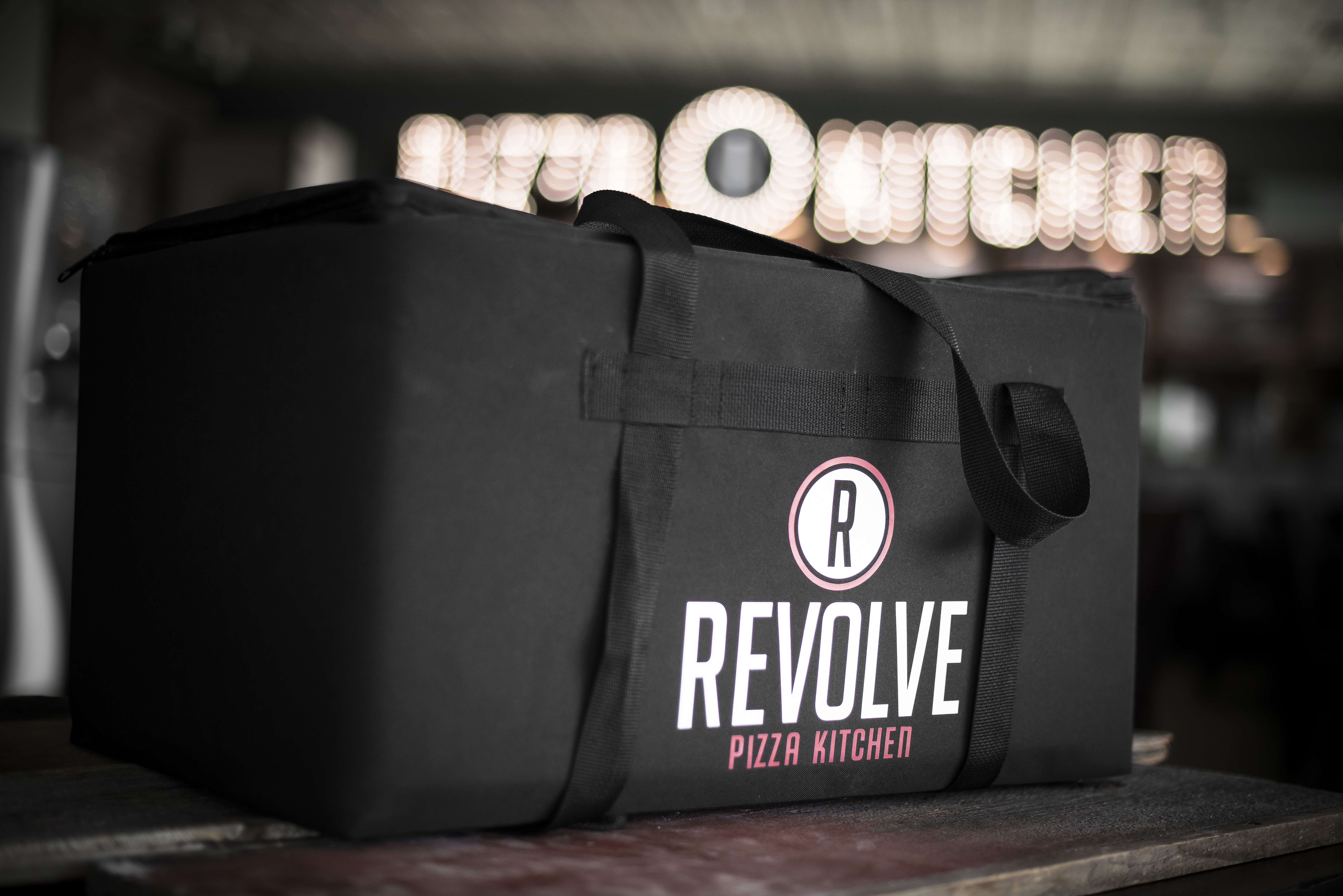Revolve workers deliver the customizable fast-casual pizza experience